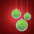 Stock Photo: Red Christmas card. Three green Christmas balls with twirls decoration.