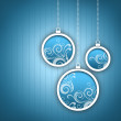 Stock Photo: Blue Christmas card. Three Christmas balls with twirls decoration.