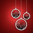 Stock Photo: Red Christmas card. Three Christmas balls with twirls decoration.