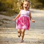 Happy girl green meadow field track — Stock Photo