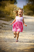 Happy girl green meadow field track — Stock Photo