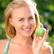 Stock Photo: Girl in hands holds apple