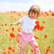 Girl on meadow with a red poppies — Stock Photo #12127945
