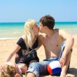 Stock Photo: Young family on the beach,focus is mainyly on the mothers face