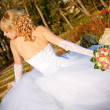 Stock Photo: Lovely sensual bride unzip her wedding dress