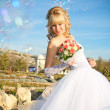 Stock Photo: The bride and soap bubbles