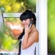 Stock Photo: Portrait of beautiful young woman speaking on phone