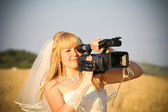 Bride video operator with HDV camcorder — Stock Photo