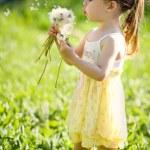 Little girl closeup portrait with dandelion — Stock Photo #12131889