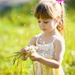 Little girl closeup portrait with dandelion — Stock Photo