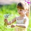 Stock Photo: Little girl closeup portrait with dandelion