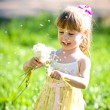 Little girl closeup portrait with dandelion — Stock Photo #12131894