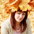 Young woman in autumn — Stock Photo