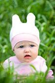 Happy baby on grass — Stock Photo