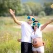 Young family with a sun on the nature — Stock Photo