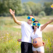 Stock Photo: Young family with sun on nature