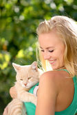 Beautiful girl holds on hands of kitten. — Stock Photo
