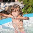 Little girl in swimming pool. — Stock Photo