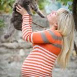 Beautiful girl holds on hands of kitten. — Stock Photo #29134727