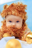 Portrait of beautiful newborn baby in hat of tinsel — Foto Stock