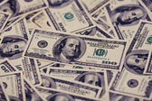 One hundred dollars pile as background. — Stock Photo
