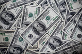 One hundred dollars pile as background — Stock Photo