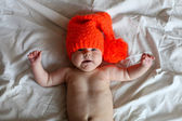 The baby in a orange  knitted — Stock Photo