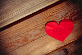 Red hearts on old shabby wooden background — Stock fotografie