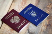 Ukrainian and Russian passports isolated on white background — Zdjęcie stockowe