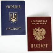 Ukrainian and Russian passports isolated on white background — Stok fotoğraf