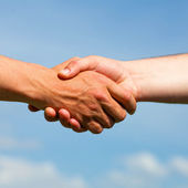 Shaking hands of two business people — Stock Photo