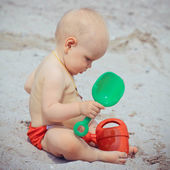 Portrait of kid resting on the beach in summer — Stock Photo