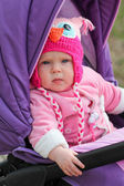 Cute baby sitting in the stroller — Stock Photo