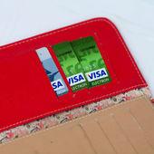 KIEV, UKRAINE - July 16: Pile of credit cards, Visa cards  with US dollar bills, in Kiev, Ukraine, on July 16, 2014. — Stock Photo
