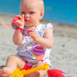 The small child is played in a toy on a beach — Stock Photo #50133613