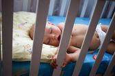 Newborn sleep in crib — Stock Photo