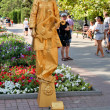 Постер, плакат: Sevastopol Russian Federation 27 of July 2014: Street artist dressed as a gold statue in honor of a holiday of navy of Russia
