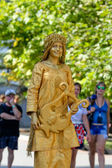 Sevastopol, Russian Federation-27 of July, 2014: Street artist dressed as a gold statue in honor of a holiday of navy of Russia — Stock Photo