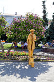 Sevastopol, Russian Federation-27 of July, 2014: Street artist dressed as a gold statue an position,in honor of a holiday of navy of Russia — Stock Photo