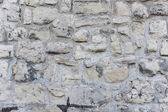 Rought stone wall with beige, white and grey stone — Stock Photo