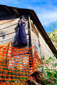 Vest hanging on a wooden barn — Stock Photo