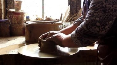 Two hands are molding clay into a vase. — 图库视频影像