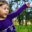 Outdoor portrait of cute little girl on the meadow — Stock Photo #37086141