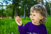Outdoor portrait of cute little girl on the meadow — Stock Photo
