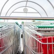 Supermarket shopping carts in row — Stock Photo #37595755