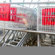 Supermarket shopping carts in row — Stock Photo #37596709