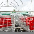 Supermarket shopping carts in row — Stock Photo #37596713