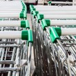 Supermarket shopping carts in row — Stock Photo #37597623