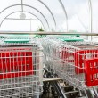 Supermarket shopping carts in row — Stock Photo #37598189