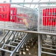 Supermarket shopping carts in a row — Stock Photo